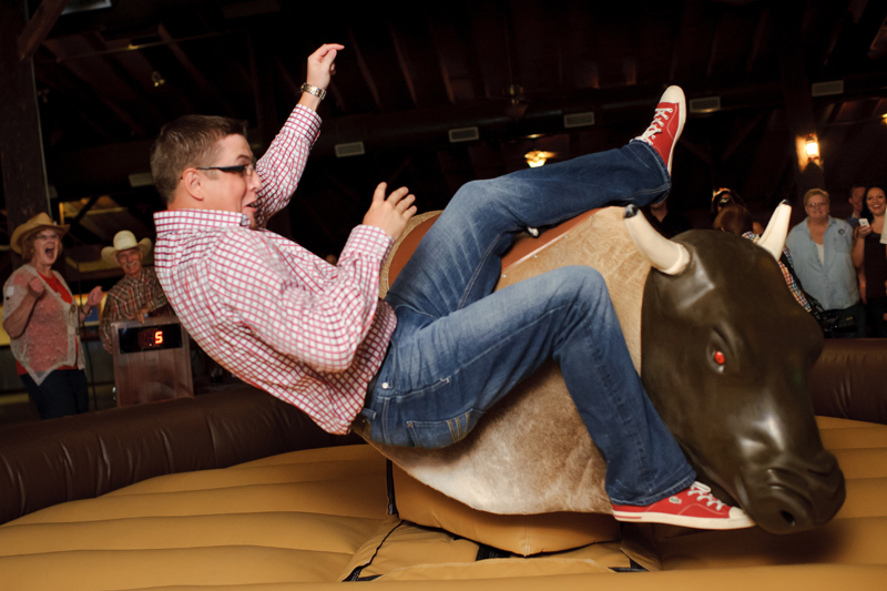 Texas style mechanical bull riding at a wedding reception at Circle R Ranch in Flower Mound (1)
