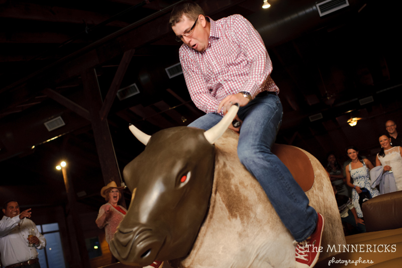 Texas style mechanical bull riding at a wedding reception at Circle R Ranch in Flower Mound (2)