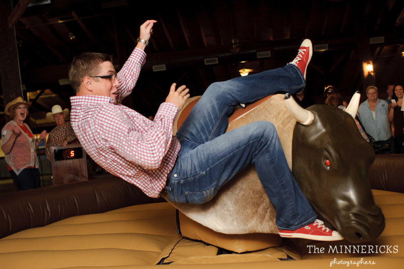 Texas style mechanical bull riding at a wedding reception at Circle R Ranch in Flower Mound (4)