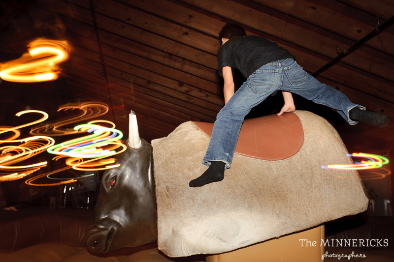 Texas style mechanical bull riding at a wedding reception at Circle R Ranch in Flower Mound (5)