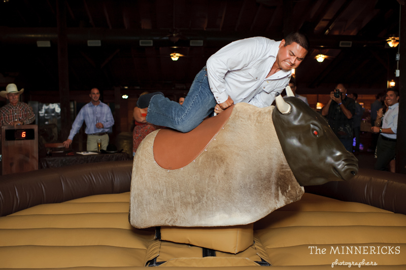 Texas style mechanical bull riding at a wedding reception at Circle R Ranch in Flower Mound (6)