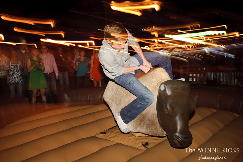 Texas style mechanical bull riding at a wedding reception at Circle R Ranch in Flower Mound (8)