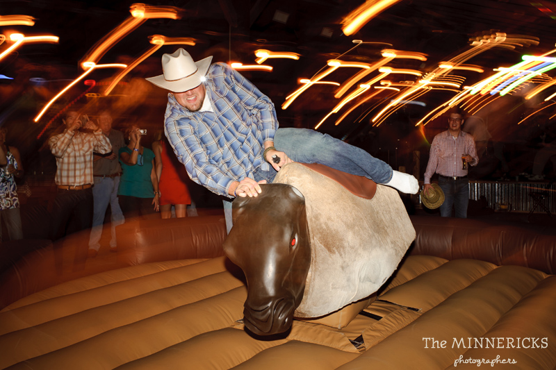 Texas style mechanical bull riding at a wedding reception at Circle R Ranch in Flower Mound (9)