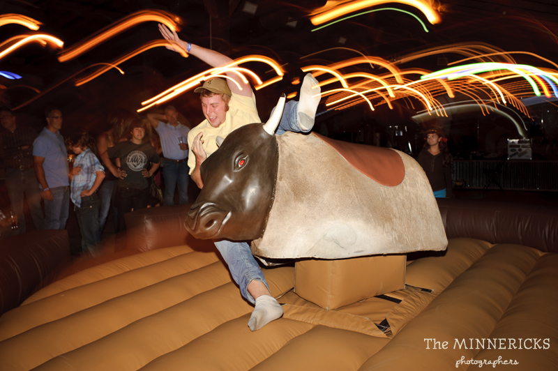 Texas style mechanical bull riding at a wedding reception at Circle R Ranch in Flower Mound (12)