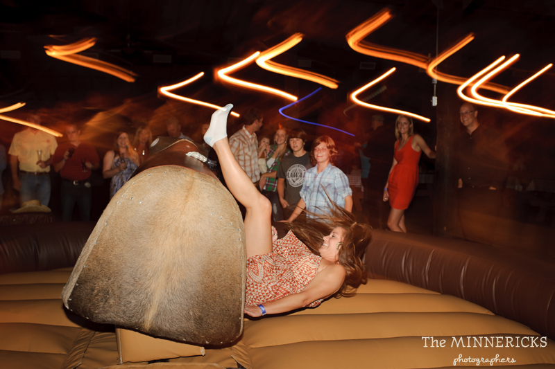 Texas style mechanical bull riding at a wedding reception at Circle R Ranch in Flower Mound (15)