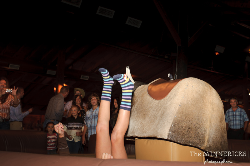 Texas style mechanical bull riding at a wedding reception at Circle R Ranch in Flower Mound (16)